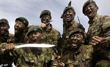 gurkha regiment posing for picture with khukri knife