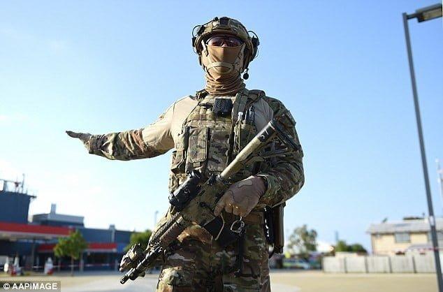 TAG Operator brandishing his gun