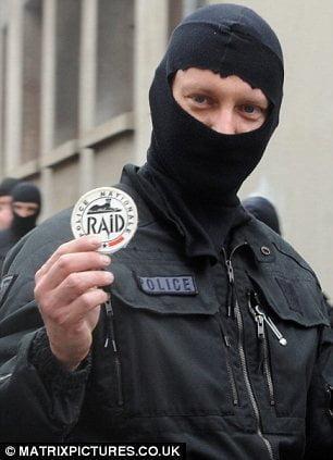 RAID member brandishing unit's insignia