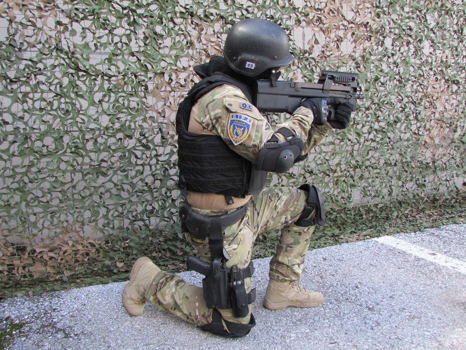 member of SIPA swat brandishing weapon